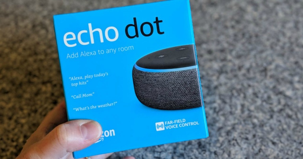 Echo Dot 3rd Gen being held by a woman's hand