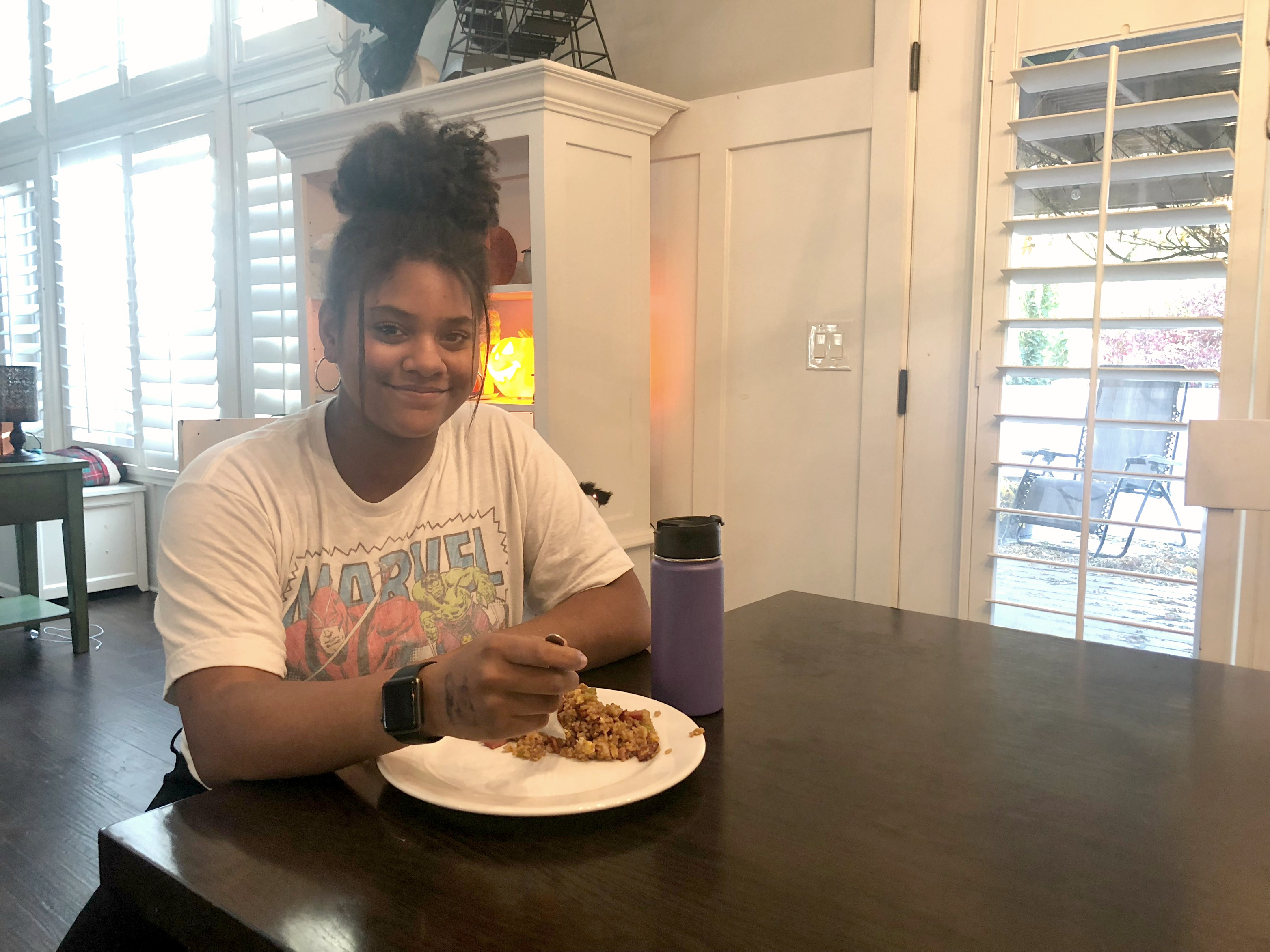 meal planning tips busy family – beautiful smiling daughter enjoying dinner