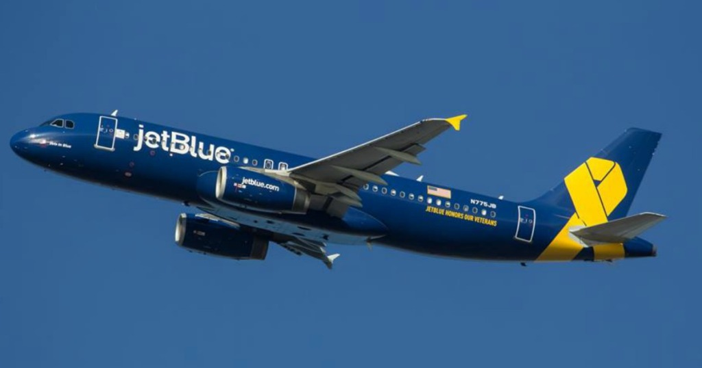 commercial airplane in the sky blue and yellow