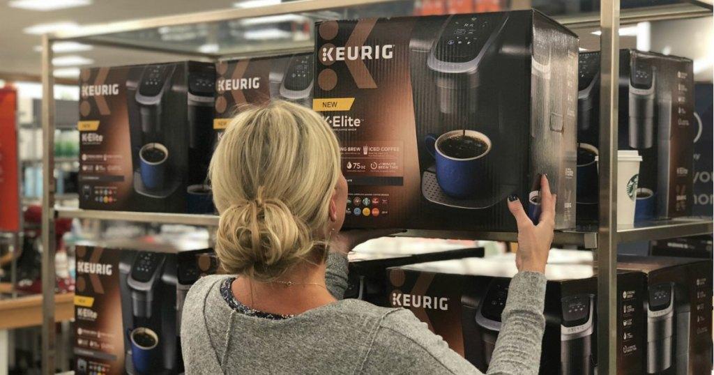 woman holding box of keurig coffee maker