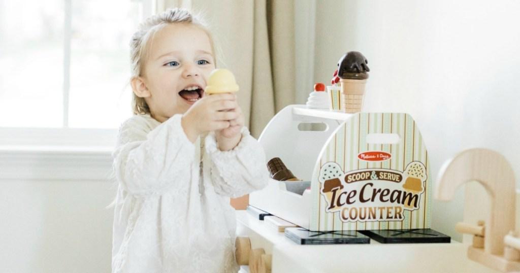 little girl playing with Melissa & Doug ice cream counter