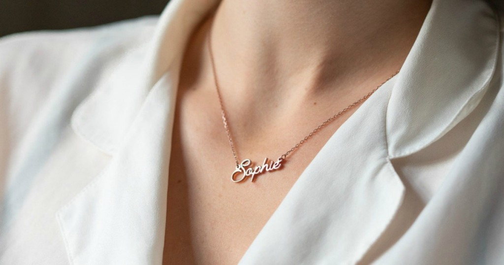 gold name necklace on woman