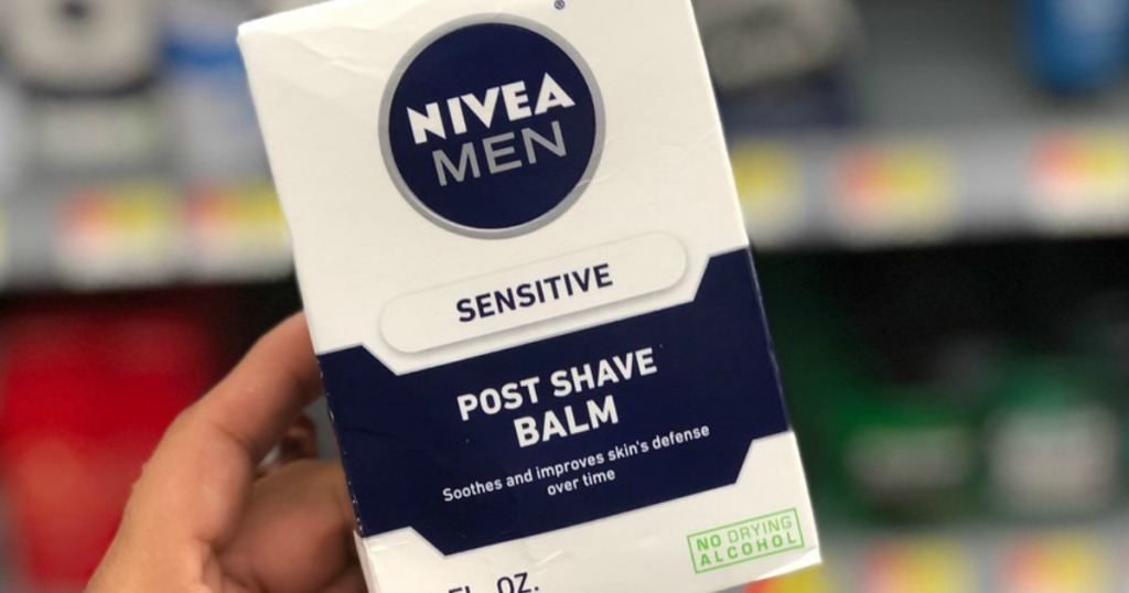 Box of nivea shave balm held by hand