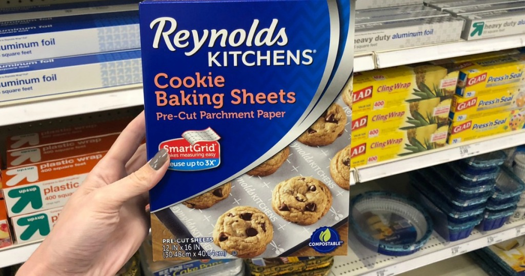hand holding package of Reynolds cookie baking sheets