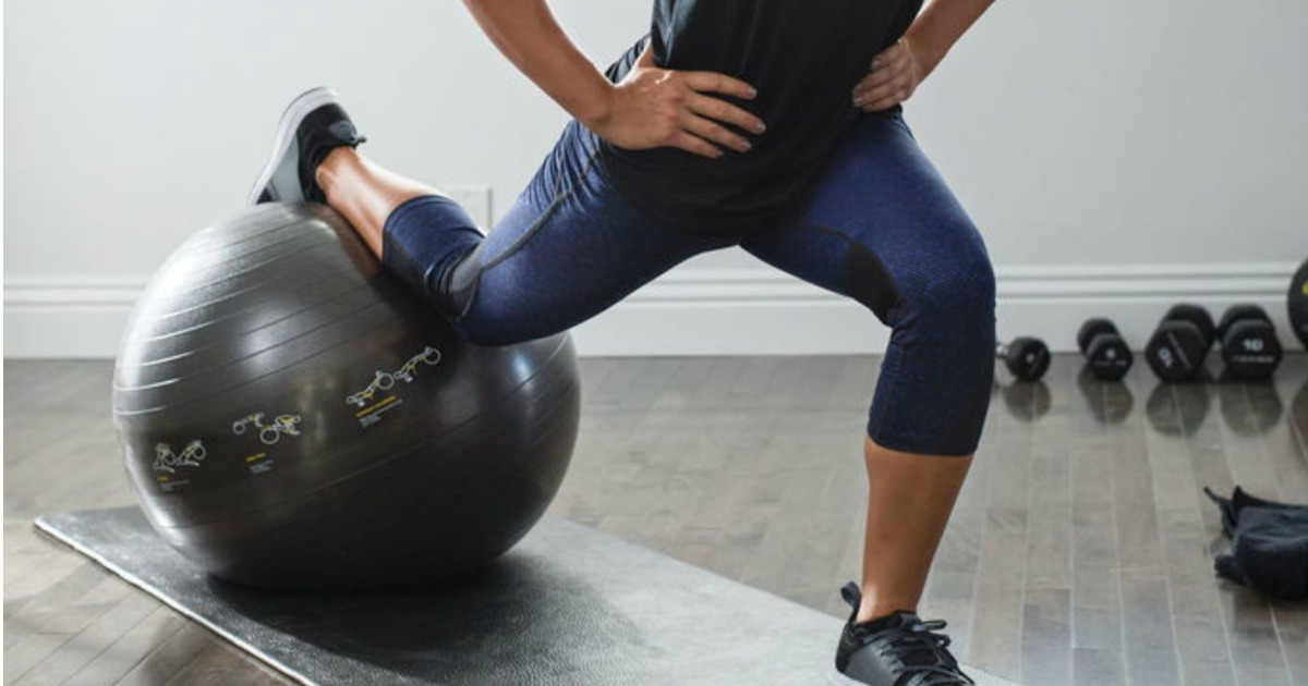 woman exercising with a yoga ball