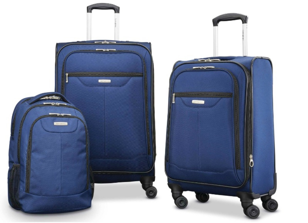 three pieces of blue luggage