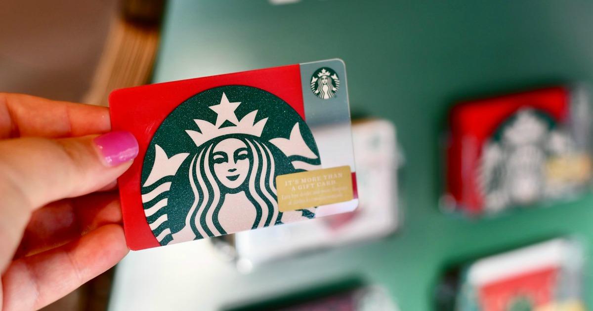 starbucks gift card held by hand