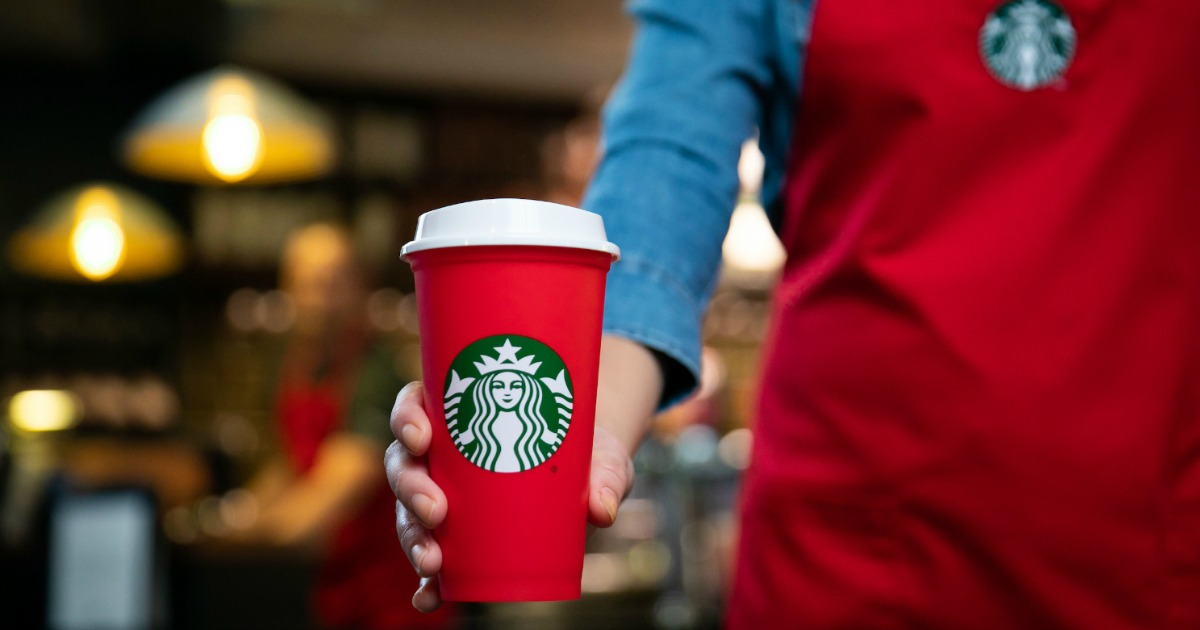 Barista with red Starbucks cup