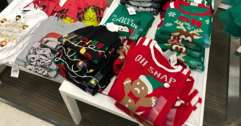 christmas sweaters on display in store