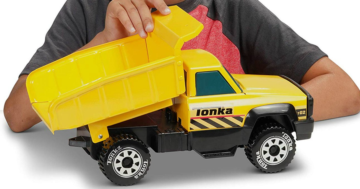boy playing with Funrise Tonka Dump Truck
