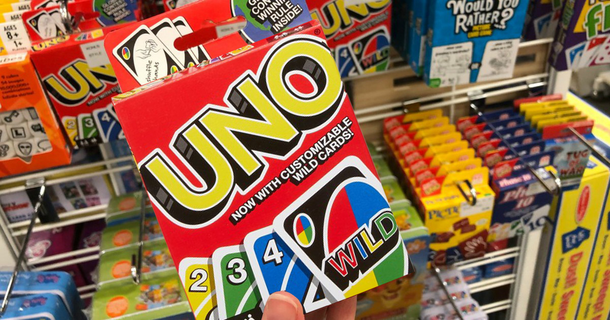 hand holding UNO card game box in store