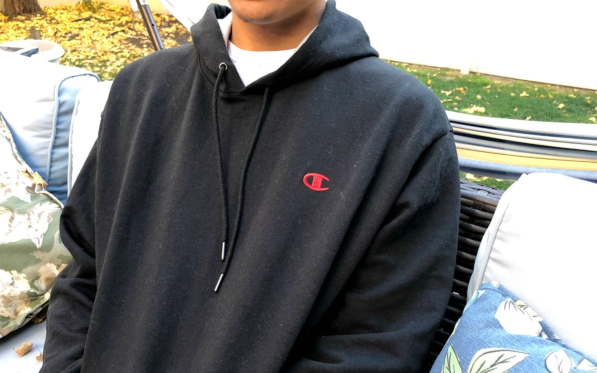 man wearing gray Champion hoodie