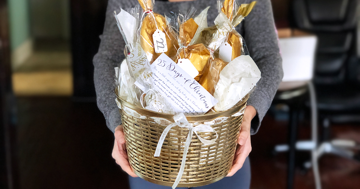 woman holding diy advent calendar with gold basket