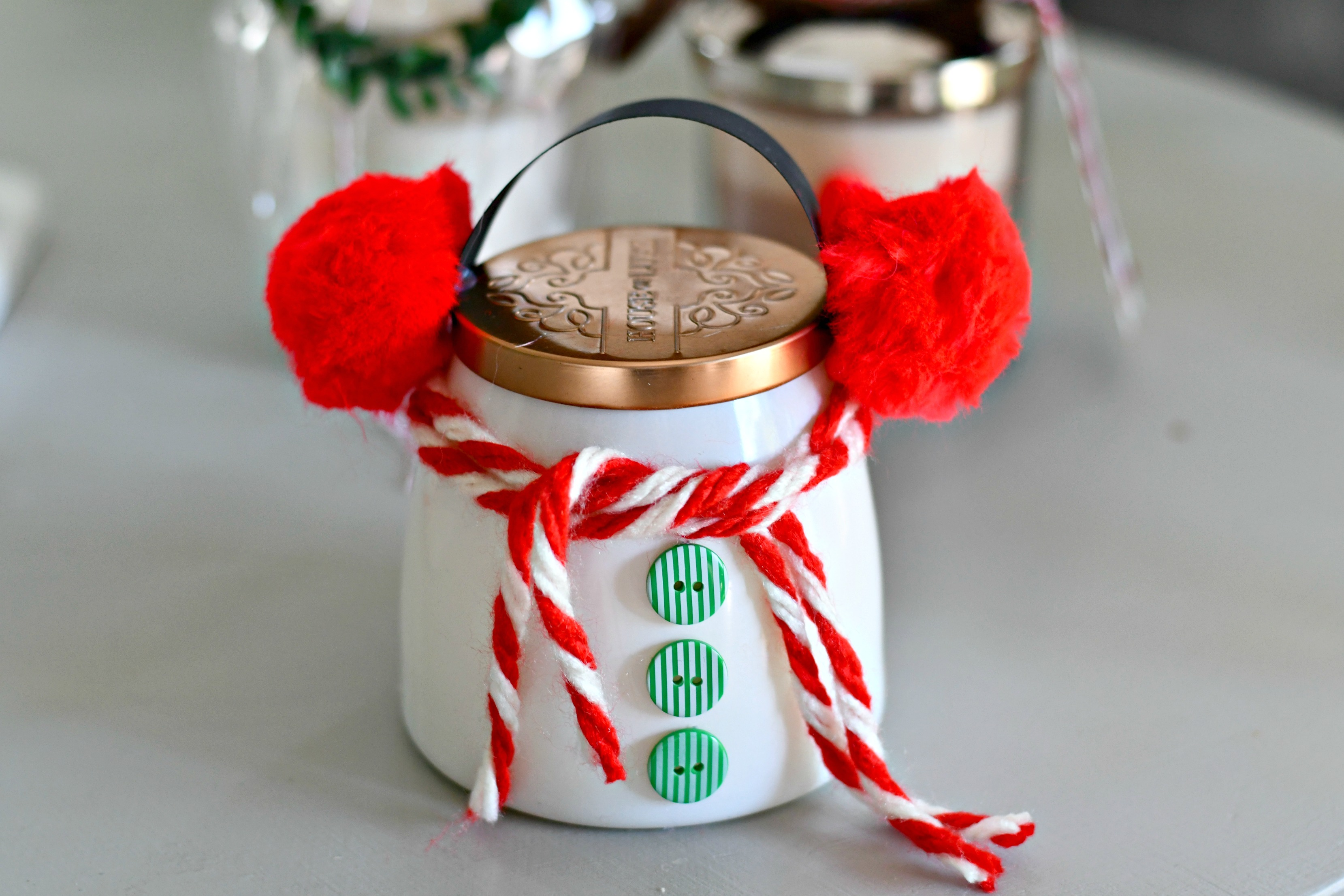 easy diy christmas candle gift ideas – snowman candle with earmuffs