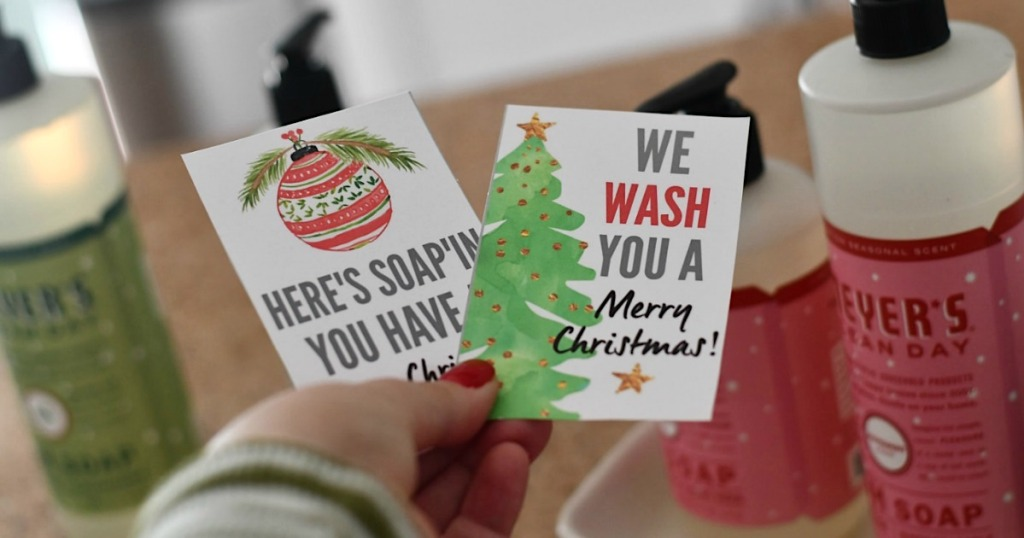 holding printable soap gift tags with Mrs. Meyer's in the background