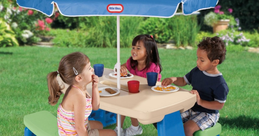 kids sitting at little tikes table