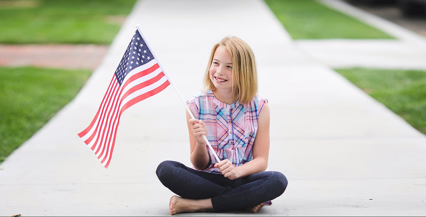 piper holding an American flag