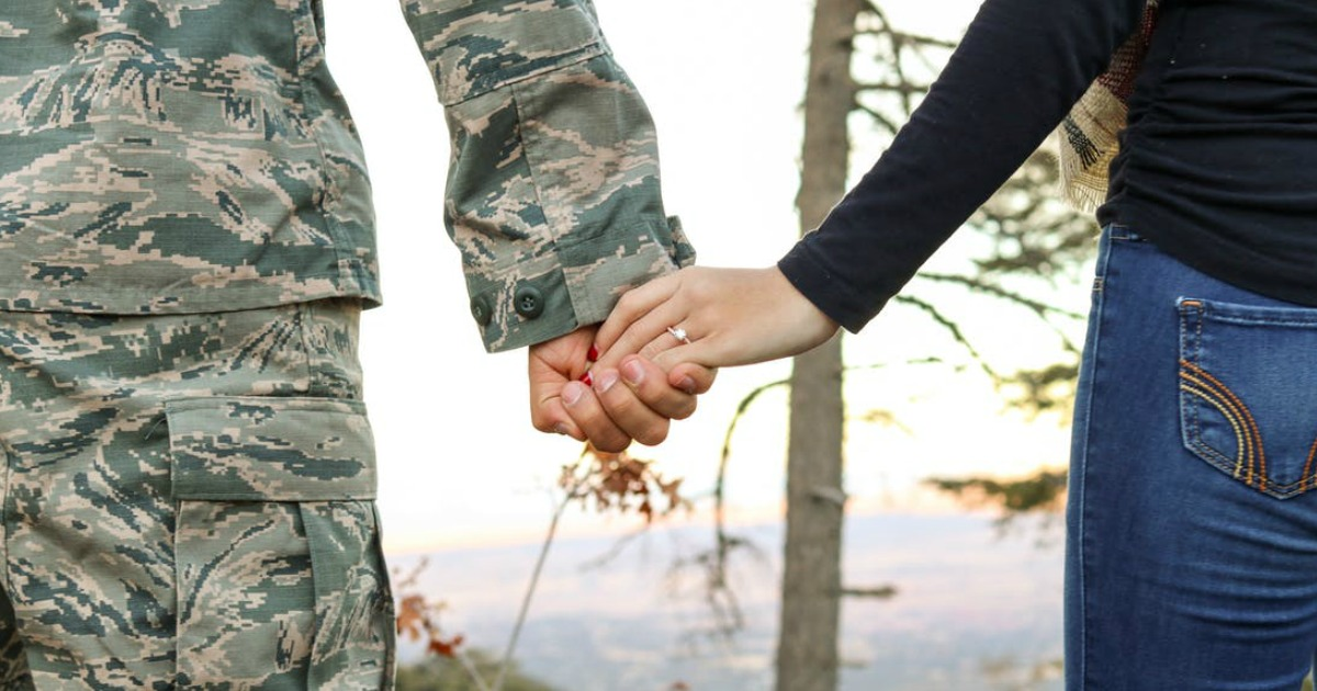military spouses holding hands
