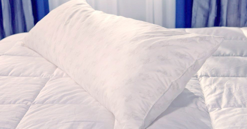 body pillow on top of a bed