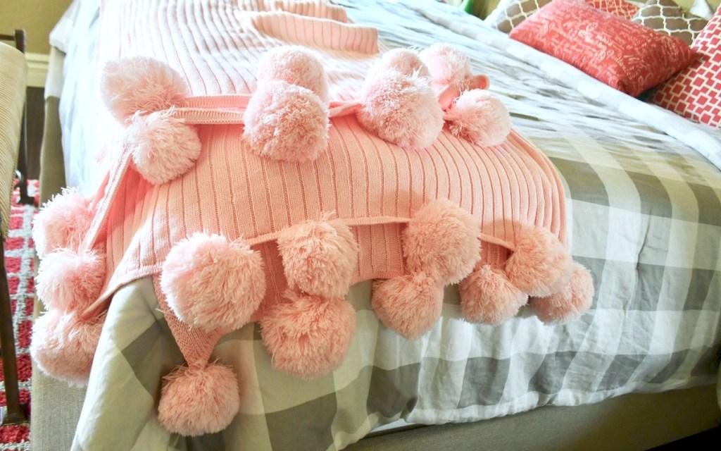 gift guide for homebody — pom pom blanket on bed