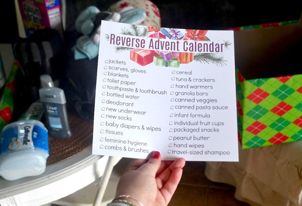 hand holding reverse advent calendar printable