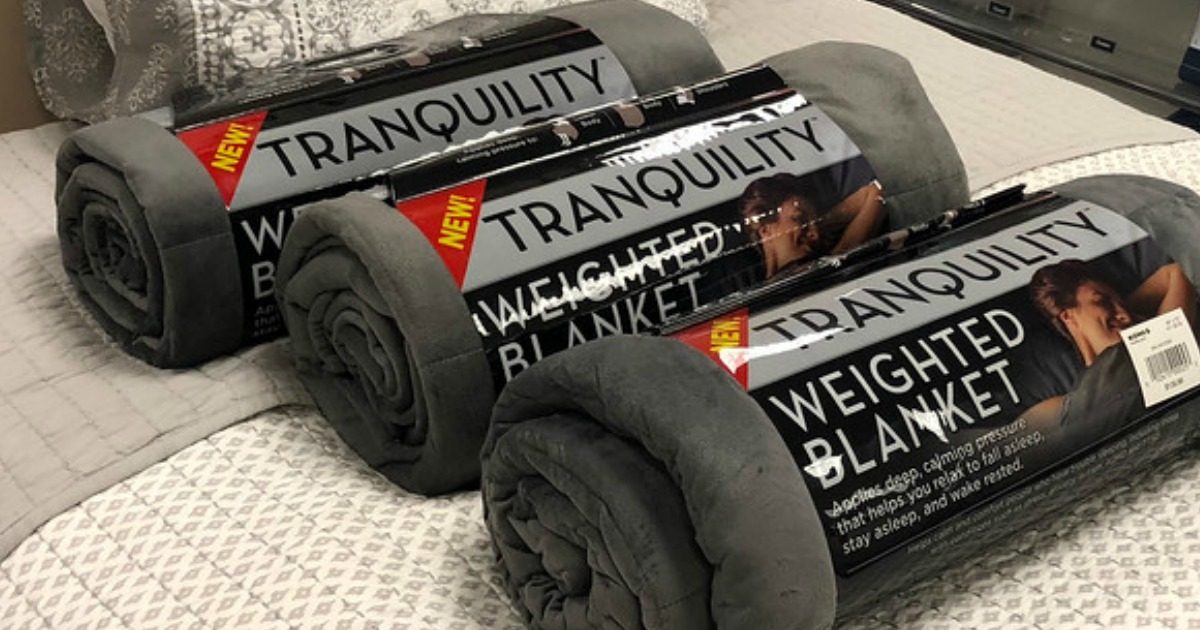 Tranquility Weighted Blanket on a bed from Walmart