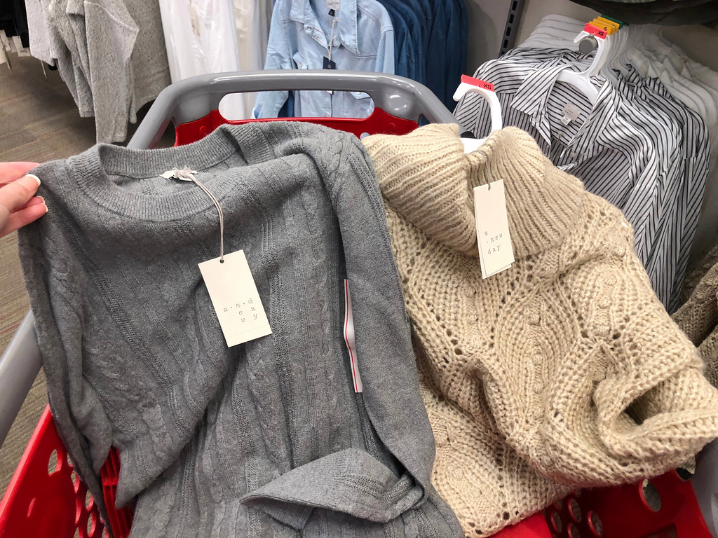 two sweaters in cart