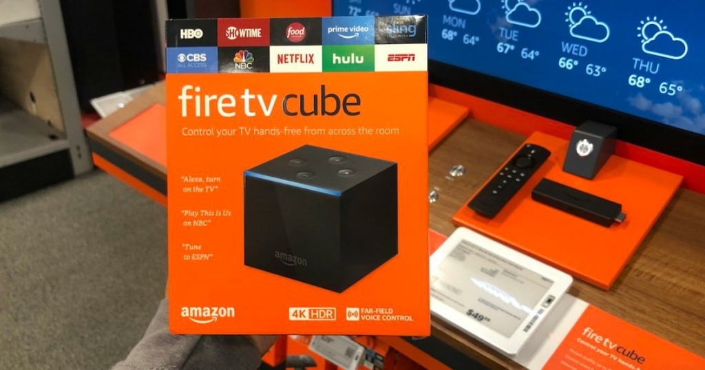 holding fire TV cube in box