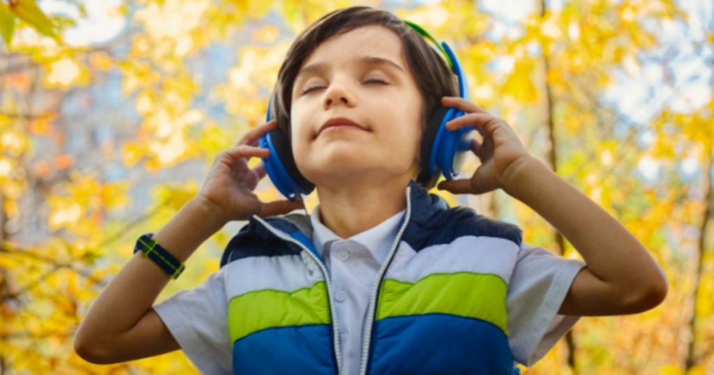 Boy with headphones listening to music