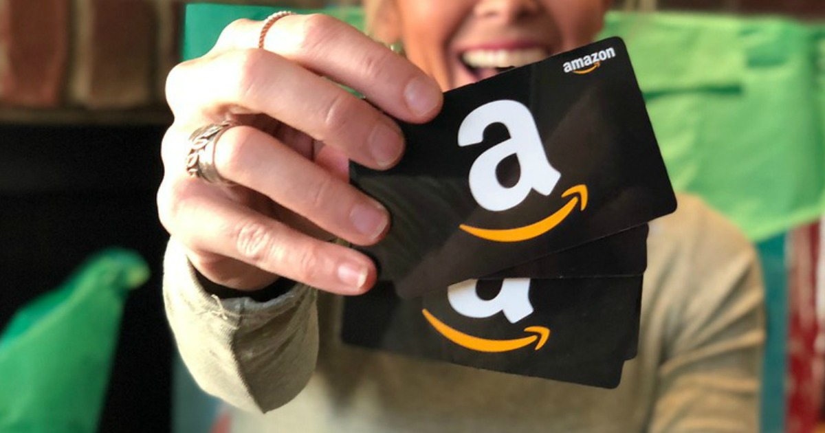 collin holding Amazon gift cards