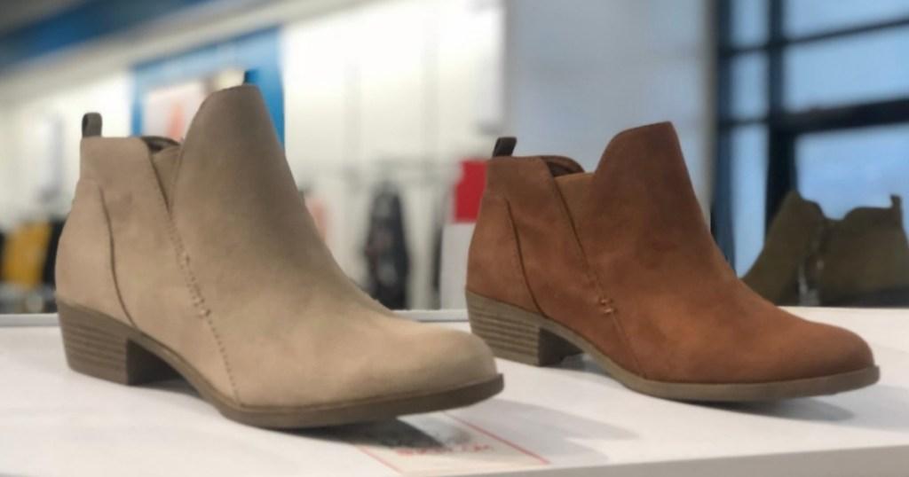 American Rag Cadee Boots on display at Macy's