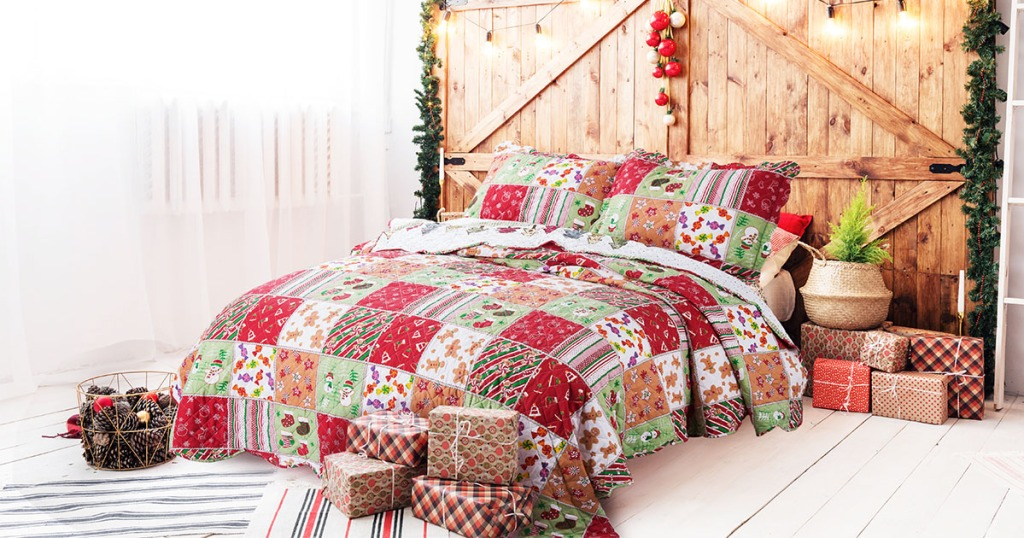 christmas quilt in bed with Christmas decor