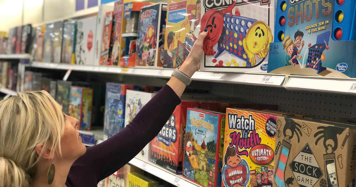 best board card games kids adults families – Collin at the store looking at games