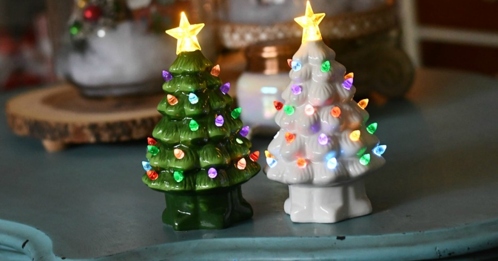 two lit up ceramic Christmas trees