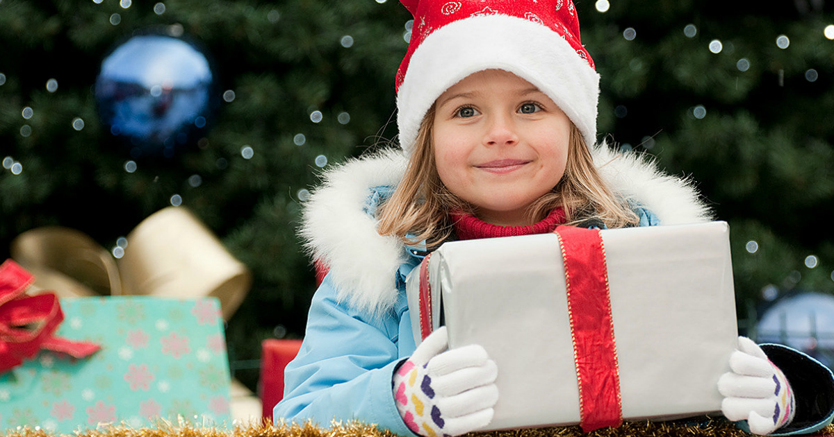 Christmas presents and young girl - free shoprunner membership