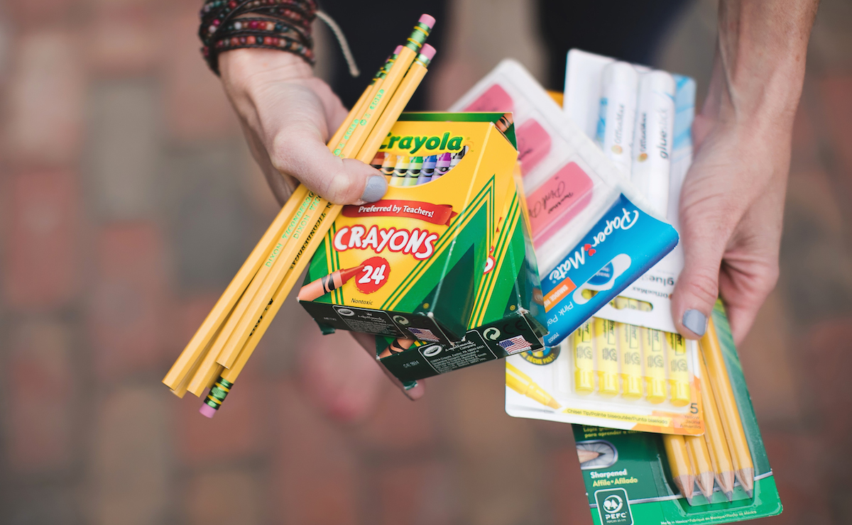 simple thoughtful ways to pay-it-forward in the new year – Collin with school supplies