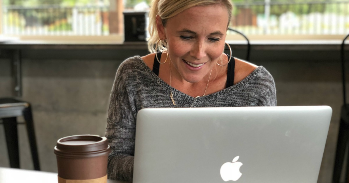 Collin shopping online using MacBook