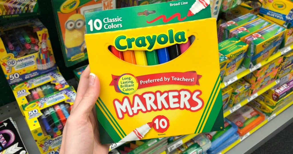 classic crayola markers held up in front of store aisle