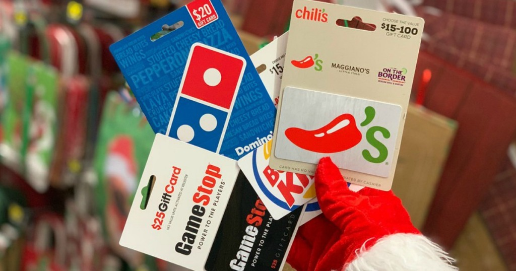 santa hand holding gift cards