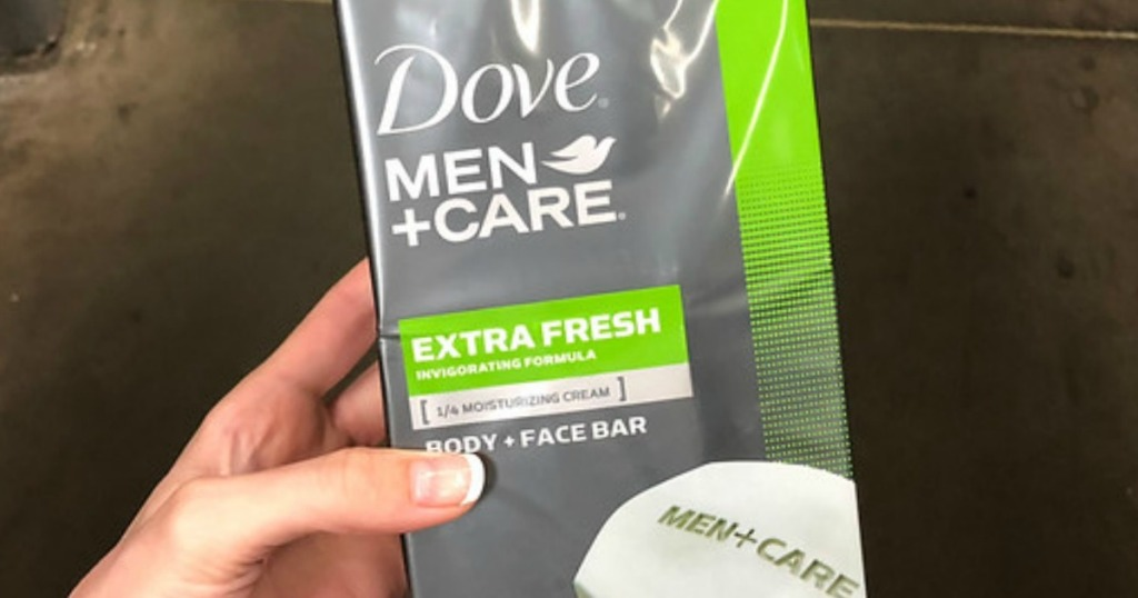 hand holding a package of dove men+care bars