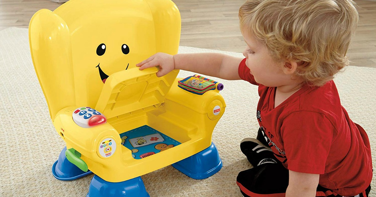 boy playing with fisher price chair