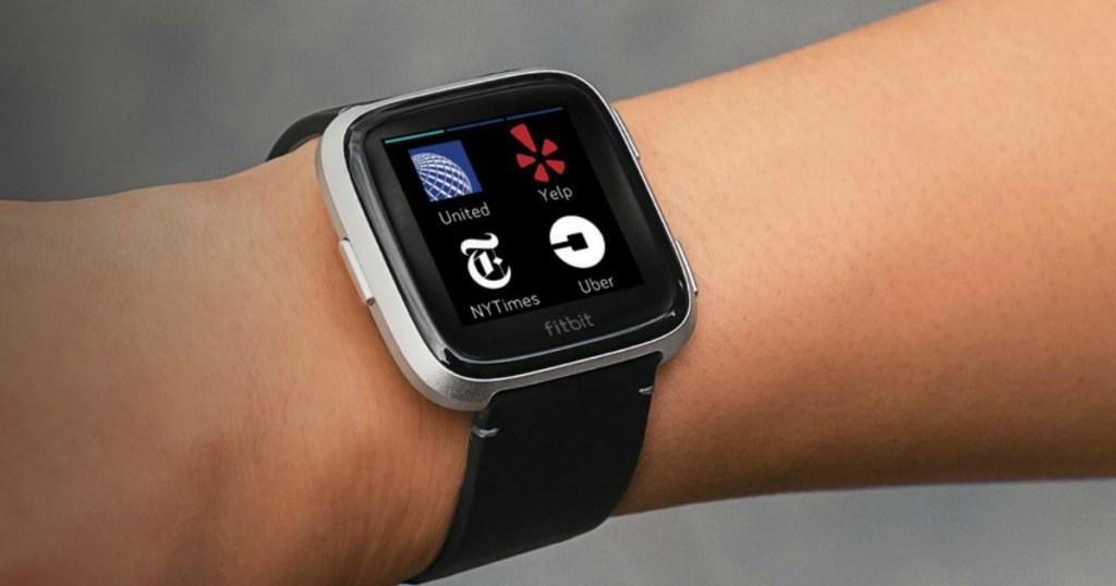 arm wearing a Fitbit Versa 2 Smartwatch