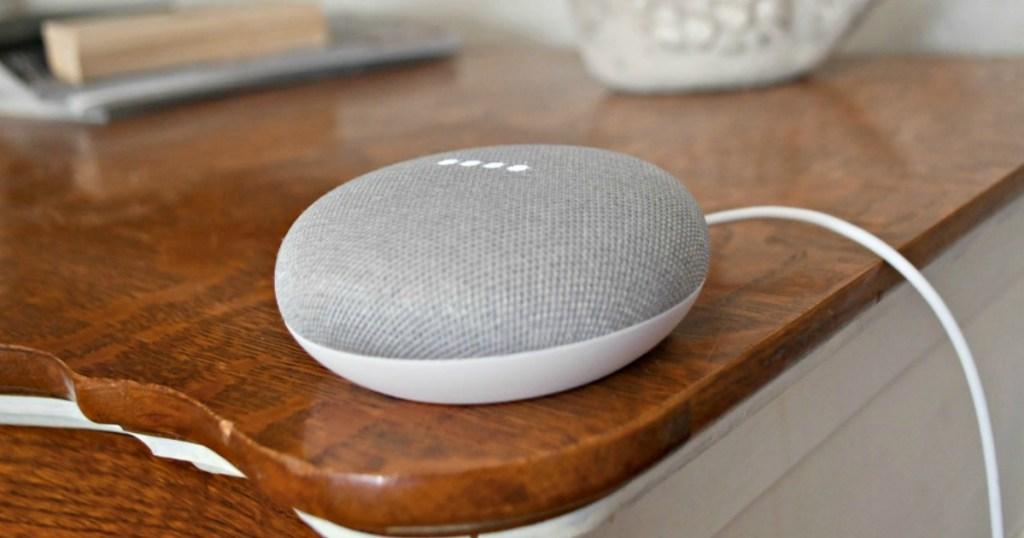 Google Home Mini Speaker on side table