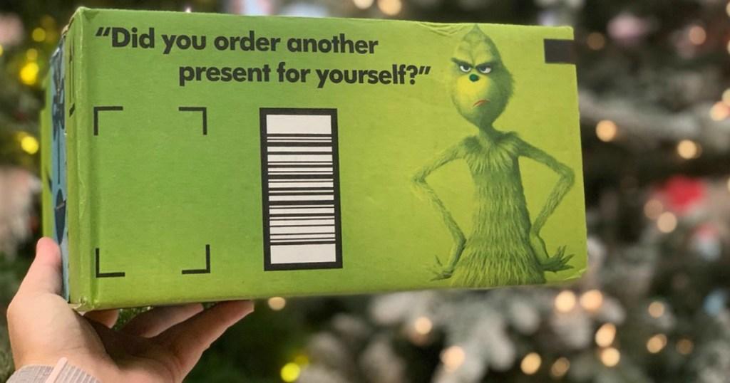 holding green shipping box