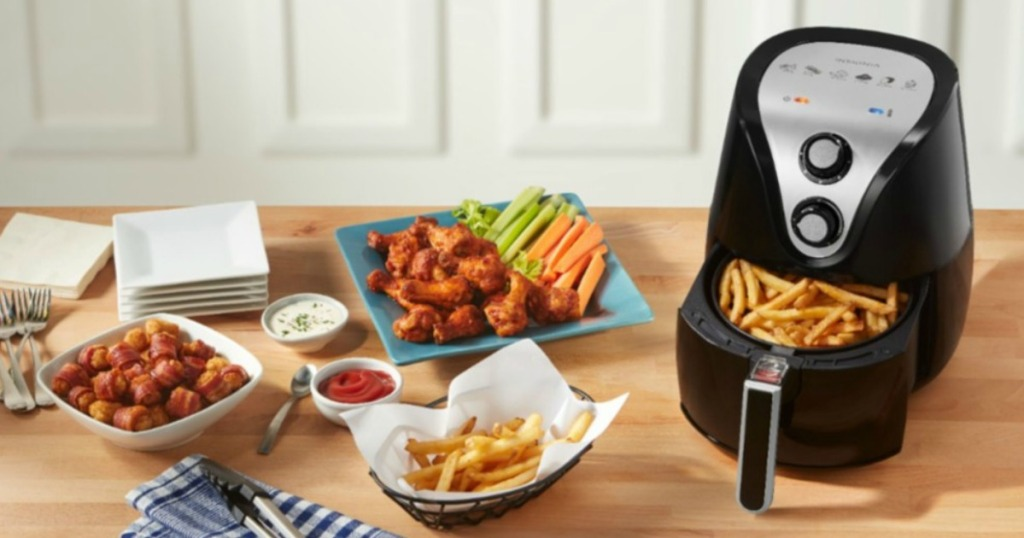 Insignia Air Fryer on table with food