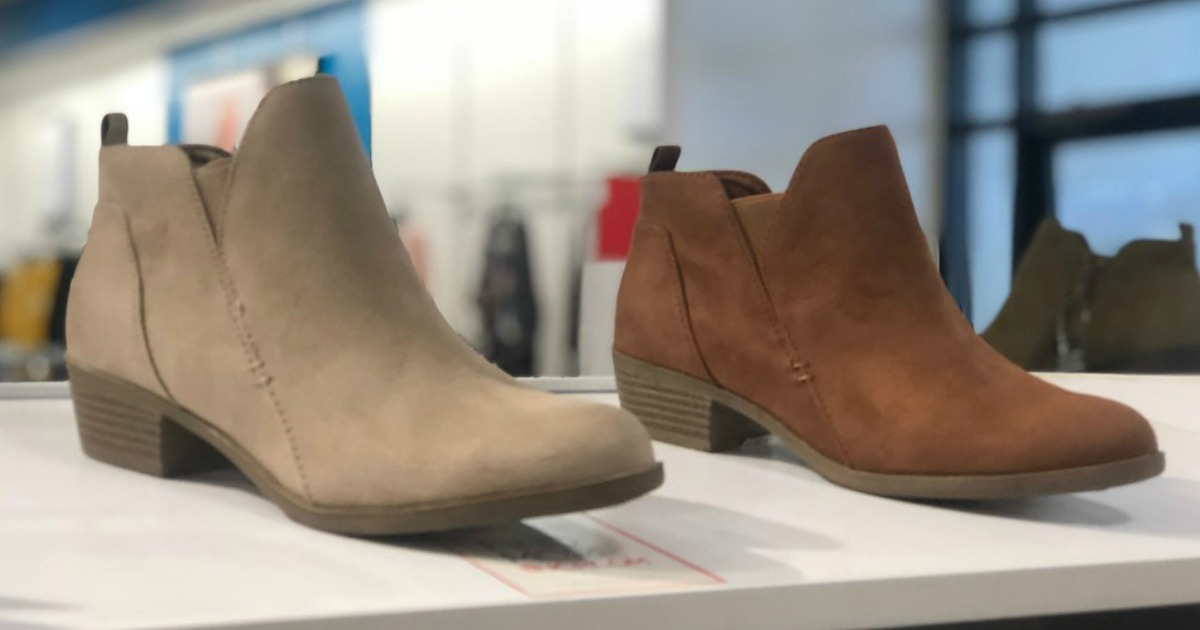 two pairs of women's boots on a shelf at JCPenney