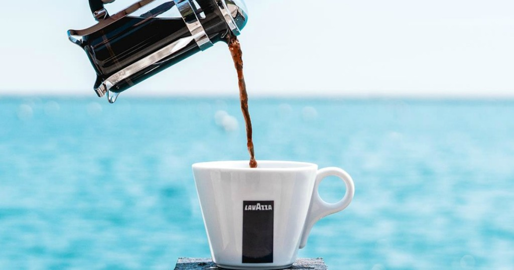 Lavazza Coffee being poured from a French press into a mug
