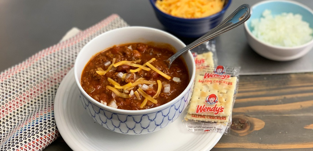 Wendy's Copycat Chili Recipe - bowl of chili with cheese and onions