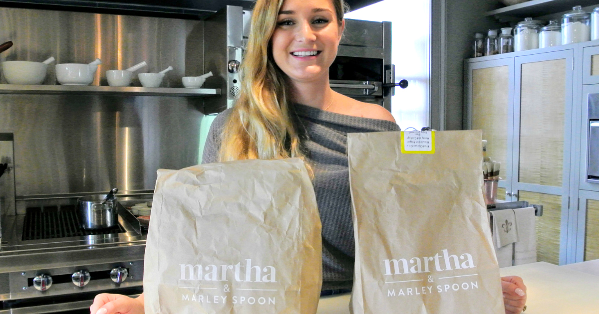 Martha & Marley Spoon box deal – smiling woman holding two Martha & Marley spoon bags