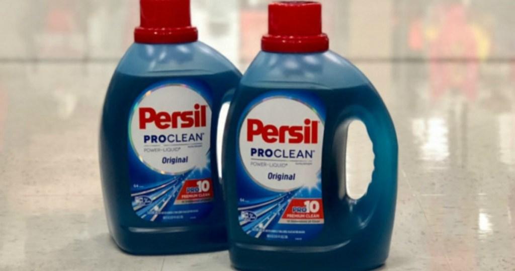 Persil Pro Clean 75 oz Liquid Detergent bottles on floor of store